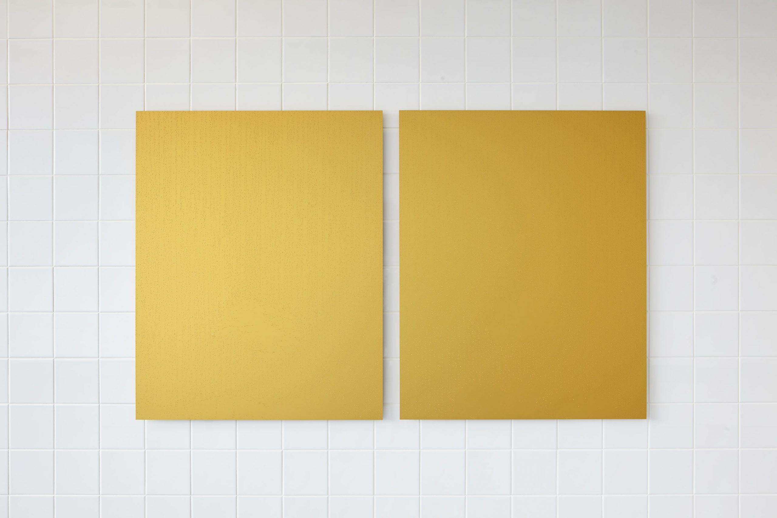 Two gold aluminium panels with clear resin droplets.