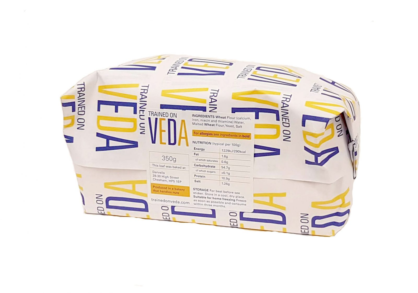 Paper wrapped Veda loaf, with nutritional label